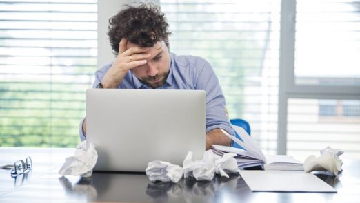 Stressed-Man-with-Laptop-in-Office